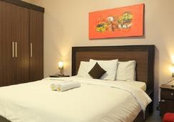 RedDoorz @ Kartika Plaza - クタ - 寝室