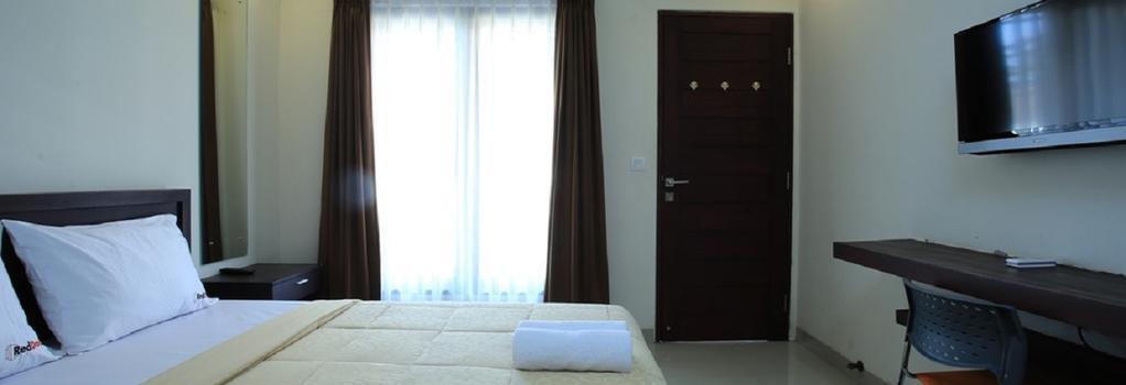 Reddoorz @ Pura Demak Marlboro - デンパサール - 寝室
