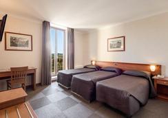 ロモリ ホテル - ローマ - 寝室