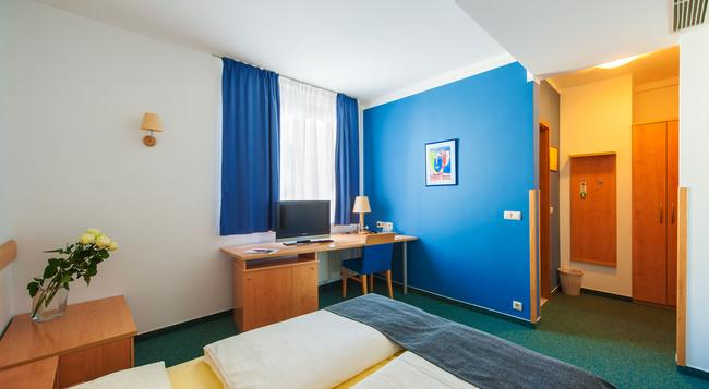 M ホテル - リュブリャナ - 寝室