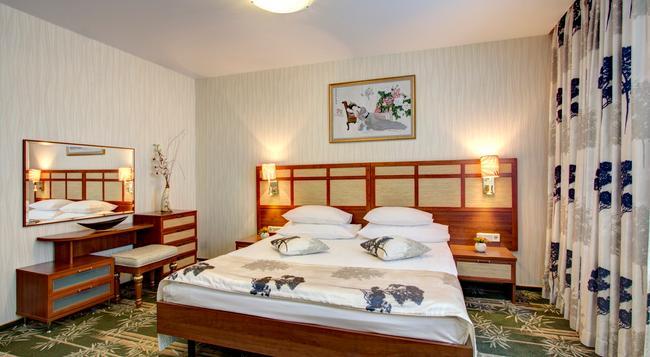 イズマイロボ アルファ ホテル - モスクワ - 寝室