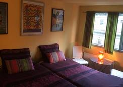 PhilDutch Houseboat Amsterdam Bed and Breakfast - アムステルダム - 寝室