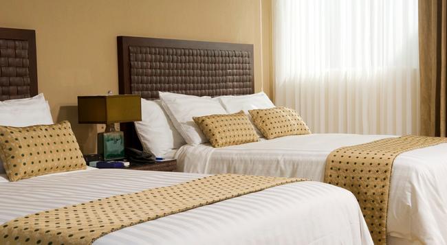 Rincón del Valle Hotel & Suites - サンホセ - 寝室