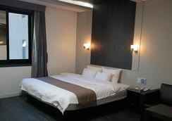 シアトルB ホテル - プサン - 寝室