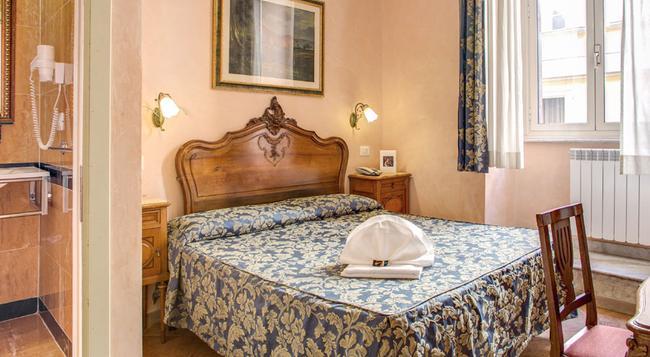 カラヴァッジョ ホテル - ローマ - 寝室