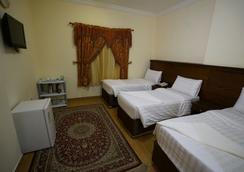 Qasr Al-Azziziah Hotel - メッカ - 寝室