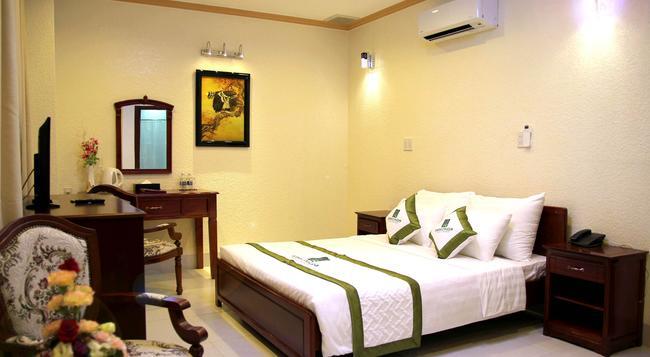 メコン 9 ホテル サイゴン - ホーチミン - 寝室
