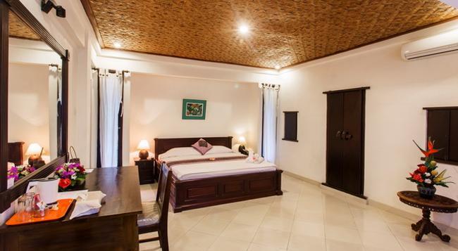 Kutuh Tirta Arum Guest House - ウブド - 寝室