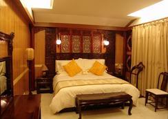 Lijiang Dian Jun Wang Hotel - 麗江 - 寝室