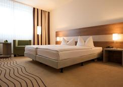 シティ ホテル ベルリン イースト - ベルリン - 寝室