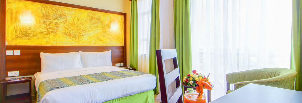 Vittoria Suites - Kisumu - Kisumu - 寝室