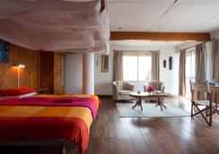 Q バー & ゲストハウス - Dar Es Salaam - 寝室