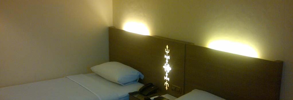 アマンズ ホテル - Ambon - 寝室