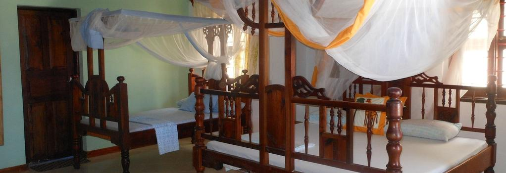 Mbuyuni Beach Village - Jambiani - 寝室