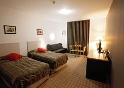 Golden Pebble Hotel - メルボルン - 寝室
