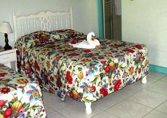 コーラル シーズ ガーデン リゾート - ネグリル - 寝室