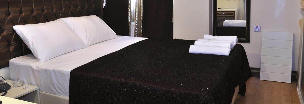 Gloria Tibi Hotel - サムスン - 寝室
