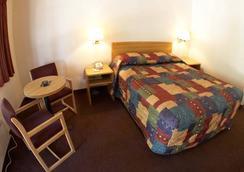 Ez 8 Motel Bakersfield - ベーカーズフィールド - 寝室