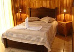 ナチュラル パシフィック スイーツホテル - Manuel Antonio - 寝室