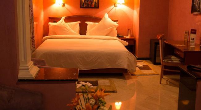 オウム パレス ホテル & スパ - カサブランカ - 寝室