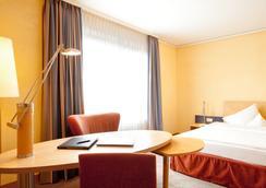 シュタイゲンベルガー ホテル レマルク - オスナブリュック - 寝室