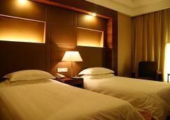 Garden International Hotel - Yangzhou - 寝室
