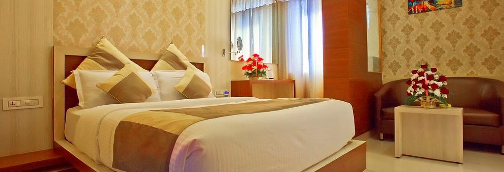 Aishwarya Suites - Mysore - 寝室
