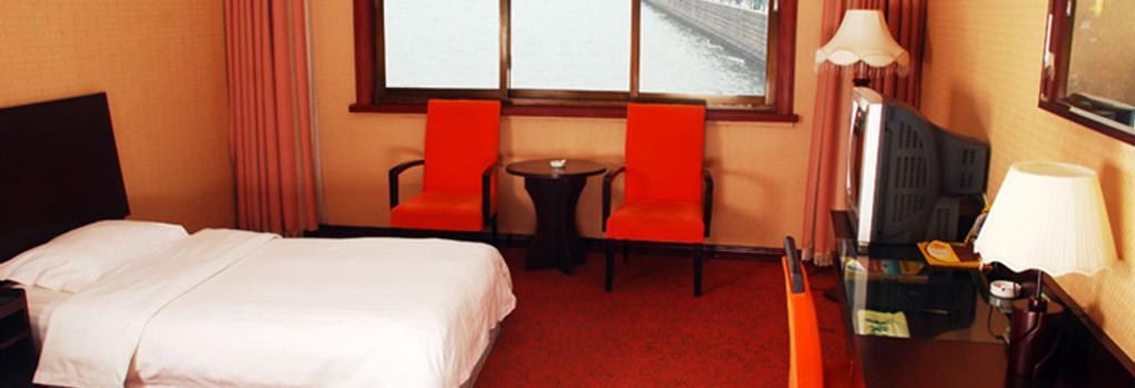 Qingdao Huaneng Hotel - 青島 - 寝室