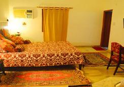 Hotel Harmony - Khajuraho - 寝室