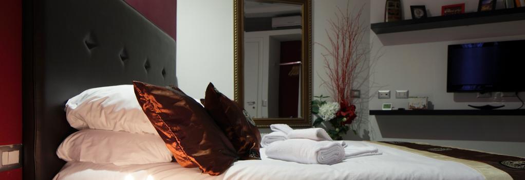 B&B ホーム 77 - ローマ - 寝室