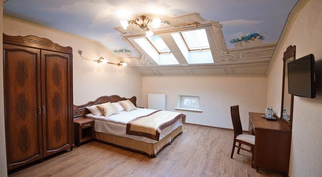 Guest House Inn Lviv - リヴィウ - 寝室