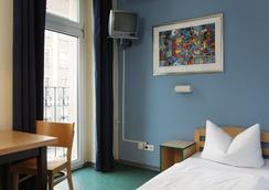 アカマ ホテル & ホステル シェーネベルク - ベルリン - 寝室