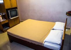 Hotel Akshaya - ヴィシャーカパトナム - 寝室