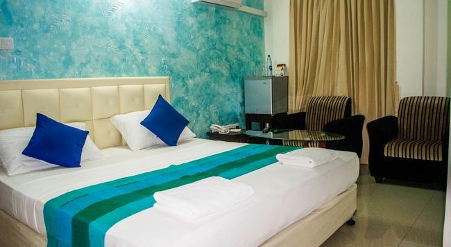 VJ シティホテル - コロンボ - 寝室