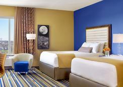 ザ ムーンライズホテル - セントルイス - 寝室